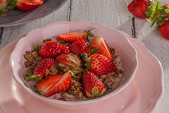 Chocolate cereal with milk and strawberries Stock Image