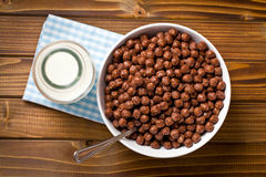 Chocolate cereals in bowl and milk in jar Royalty Free Stock Photography