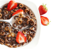 Chocolate cereals and strawberries for breakfast closeup. Royalty Free Stock Photo