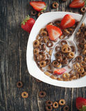 Chocolate cereals and strawberries for breakfast Royalty Free Stock Photos