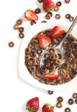Chocolate cereals and strawberries for breakfast Royalty Free Stock Images
