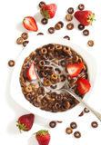 Chocolate cereals and strawberries for breakfast Royalty Free Stock Photo