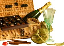Chocolates and champagne hamper Stock Images