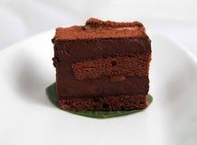 Chocolate charlotte mousse cake. On white background Stock Photos