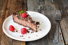 Chocolate cheescake or chocolate pie slice on white plate Royalty Free Stock Photography