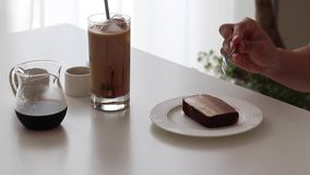 Chocolate cheese cake and ice coffee with chocolate syrup and milk stock photos