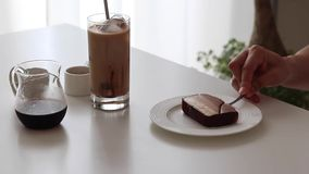 Chocolate cheese cake and ice coffee with chocolate syrup and milk stock photo