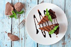 Chocolate cheesecake above view over rustic blue wood Stock Image
