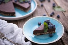 Chocolate cheesecake with blueberries stock image