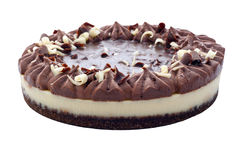 Chocolate Cheesecake. Chocolate cheese cake with a sticky mousse and sprinkled with white and dark chocolate on an isolated white background with a clipping path Royalty Free Stock Photography