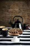 Chocolate cheesecake with cookie crust, cream and nuts Stock Photo