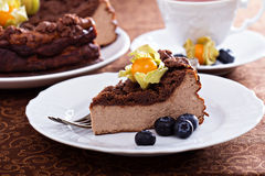 Chocolate cheesecake with crumb topping. And berries royalty free stock images