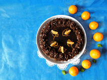Chocolate cheesecake decorated with mandarins. Chocolate cheesecake decorated with chocolate ganache surrounded by mandarins stock photo