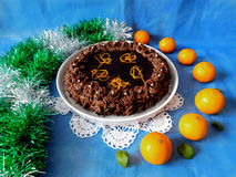 Chocolate cheesecake decorated with mandarins. Chocolate cheesecake decorated with chocolate ganache surrounded by mandarins royalty free stock photography