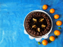 Chocolate cheesecake decorated with mandarins. Chocolate cheesecake decorated with chocolate ganache surrounded by mandarins stock photos