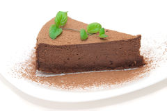 Chocolate cheesecake decorated with mint sprig Stock Images