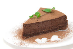 Chocolate cheesecake decorated with mint sprig. And hearts isolated on white Royalty Free Stock Image