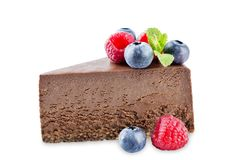 Chocolate cheesecake with fresh berries and mint leaves isolated royalty free stock images