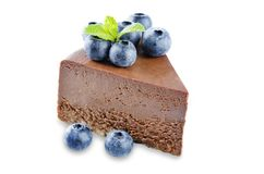 Chocolate cheesecake with fresh berries and mint leaves isolated stock photo