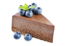 Chocolate cheesecake with fresh berries and mint leaves isolated stock photos