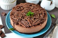 Chocolate cheesecake with mascarpone, chocolate biscuit. And ganache stock photography