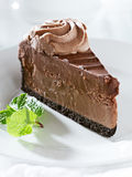 Chocolate cheesecake with mint garnish. Royalty Free Stock Photography