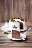 Chocolate cheesecake slice with whipped cream royalty free stock photo