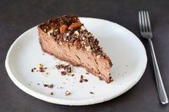 Chocolate cheesecake slice on white plate Stock Image