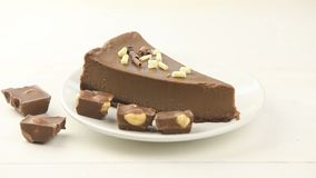 Chocolate cheesecake on white plate on   table stock footage
