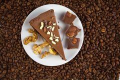 Chocolate cheesecake on white plate on  wooden table Royalty Free Stock Photos