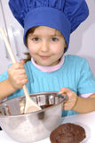 Chocolate Chef kid. Stock Photo
