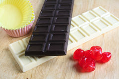Chocolate cherries and cake cups Stock Photography