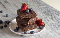 Chocolate - cherry brownie served with blueberry and strawberry. Food & Dishes for Restaurants, Cuisine of the peoples of the world, Healthy Recipes Stock Photography