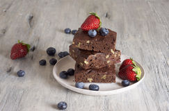 Chocolate - cherry brownie served with blueberry and strawberry. Food & Dishes for Restaurants, Cuisine of the peoples of the world, Healthy Recipes Stock Images