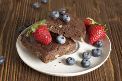 Chocolate - cherry brownie served with blueberry and strawberry. Food & Dishes for Restaurants, Cuisine of the peoples of the world, Healthy Recipes Royalty Free Stock Photography