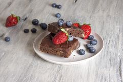 Chocolate - cherry brownie served with blueberry and strawberry. Food & Dishes for Restaurants, Cuisine of the peoples of the world, Healthy Recipes Royalty Free Stock Photo