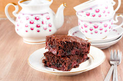 Chocolate cherry cake. And tea set Stock Photography