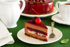 Chocolate cherry cake covered royalty free stock photography