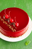 Chocolate cherry cake covered. With a mirror coating stock images