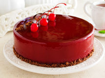 Chocolate cherry cake covered. With a mirror coating royalty free stock images