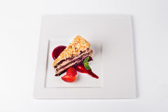 Chocolate cherry cake with strawberry on white plate background Stock Photography