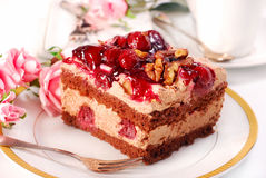 Chocolate and cherry cake with walnuts Stock Images