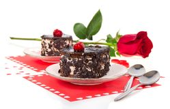 Chocolate cherry cakes and red rose Royalty Free Stock Image