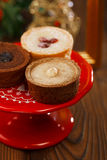 Chocolate Cherry Mini Tartlets in festive golden red style Stock Photography