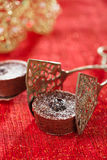 Chocolate Cherry Mini Tartlets in vintage tongs  with festive go Stock Photography