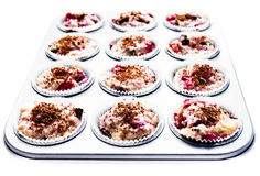 Chocolate and cherry muffin batter in a non-stick muffin tin, is Royalty Free Stock Photography