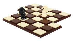 Chocolate Chessboard. Two bars of chocolate like a chessboard and chess horses Stock Images