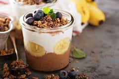 Chocolate chia pudding with banana slices stock photo