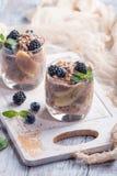 Chocolate chia pudding with banana. Vegan dessert, chocolate chia pudding with banana, berries and mint Stock Photos