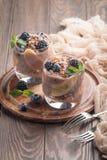 Chocolate chia pudding with banana. Vegan dessert, chocolate chia pudding with banana, berries and mint Stock Photo